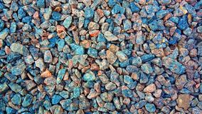 Granite gravel texture for design. Colorful stone texture: small sanded gravel. Small white, grey and blue chalk stones. Artistic. Reliefs from natural objects stock images