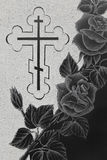 Granite gravestone with engraving picture. Black granite gravestone with engraving picture, roses ornament and christian cross royalty free stock images