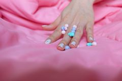 Granite Gray Nail. Close Up Nails Polish with Colourful Bead on Pink Blanket Background Stock Photo