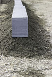 Granite kerb stone at construction site Stock Photography