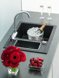 Granite kitchen sink with mixer tap Royalty Free Stock Photos