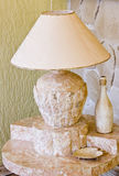 Granite lamp. A stylish lamp and table carved in stone Stock Photography