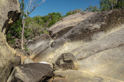 Granite landscape in the Atherton Tableland. Walking track over rocks in the Granite Gorge Nature Park Royalty Free Stock Images