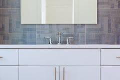 Granite modern bathroom interior with minimalist washbasin and bathtub. Bathroom washbasin Royalty Free Stock Photo
