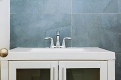 Granite modern bathroom interior with minimalist washbasin and bathtub. Bathroom washbasin Stock Photos
