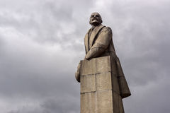 Granite monument of V.I. Lenin with a fur hat in his hand Stock Photo