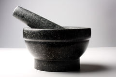Granite mortar and pestle Stock Image