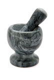 Granite mortar with  pestle isolated Royalty Free Stock Photography