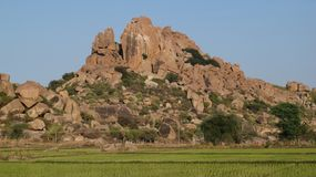 Granite mountain and rice field Royalty Free Stock Image