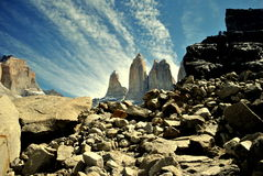 Granite mountains in Torres del Paine. Picture of the rocks with the peaks of the characteristic mountains known as Las Torres at the back. It was taken in royalty free stock images