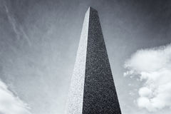 Granite Obelisk with clouds in background Royalty Free Stock Image