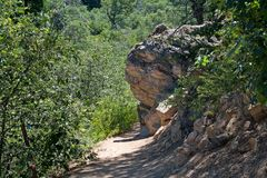 Granite outcropping on a path stock image