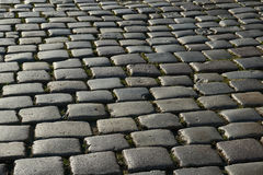 Granite paving the pavement on the market Royalty Free Stock Images