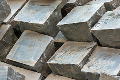 Granite paving sets stacked ready for use Stock Photo