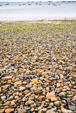 Granite pebble and boulder beach Royalty Free Stock Photos
