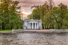 The Granite pier pavilion with the flagstaff of Elagin Palace on the Elagin Island spit in St. Petersburg Stock Photos