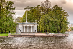The Granite pier pavilion with the flagstaff of Elagin Palace on the Elagin Island spit in St. Petersburg Stock Image