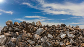 Granite pile with sky clouds. Stock Photo