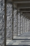 Granite pillar. Gray granite pillar - roofed course with light and shadows - portrait format royalty free stock photos