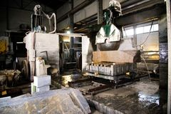 Granite processing in manufacturing. Cutting granite slab with a circular saw. Use of water for cooling. Industrial sawing of. Granite processing in stock photo