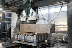Granite processing in manufacturing. Cutting granite slab with a circular saw. Use of water for cooling. Industrial sawing of. Granite processing in stock images