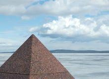 Granite pyramid. On coast of lake (Petrozavodsk, Russia royalty free stock images