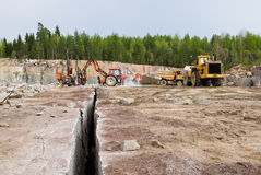 Granite quarry. Excavation and dump vehicle in a granite quarry Stock Photos
