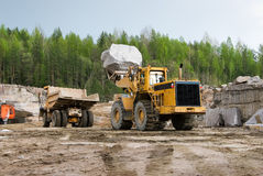 Granite quarry. Excavation and dump vehicle in a granite quarry Stock Photography