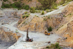 The granite quarry. With machines Royalty Free Stock Photos