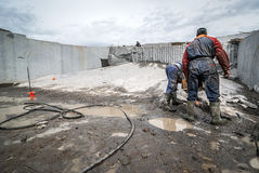 Granite quarry, prepared for removal of material, people working Royalty Free Stock Image