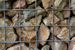 Granite retaining wall reinforced with steel grid Stock Photos