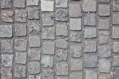 Granite roadway. Cobble Stone Road Background. Old pavement Granite roadway Royalty Free Stock Photography