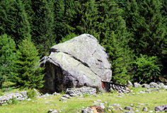 Granite rock erratic boulder. In the Alps Royalty Free Stock Photography
