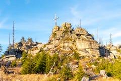 Granite rock formation with wooden cross on the top of Hochstein near Dreisesselberg, Tristolicnik. Border between