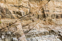 Granite rock mineral stained cliff wall background Royalty Free Stock Photography
