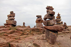 Granite Rock Stone Stack Cairn Formation. Stacks of man-made granite rock stone formations built as symbolic druid religious cairn royalty free stock photography