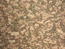 Granite rock texture. Brown/beige royalty free stock image