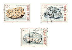 Granite rocks. Collectible old stamps from Finland. Set with granite rocks. Geology Royalty Free Stock Photos