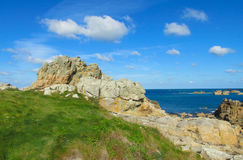 Granite rocks at beautiful sea coast Stock Images