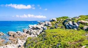 Granite rocks coastline and amazing azure water on beautiful Sardinia island near Porto Pollo, Sargedna, Italy Stock Images