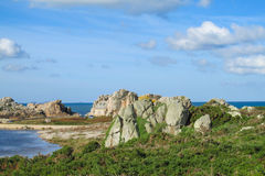Granite rocks at french sea coast Royalty Free Stock Images