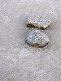 Granite rocks in frozen water Royalty Free Stock Image