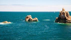 Granite rocks in ocean on shore of Ile-de-Brehat. Travel to France - granite rocks in ocean on shore of Ile-de-Brehat island in Cotes-d'Armor department of Royalty Free Stock Photos