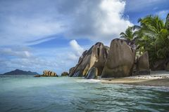 Granite rocks and palm trees at anse source d`argent 1 Stock Image