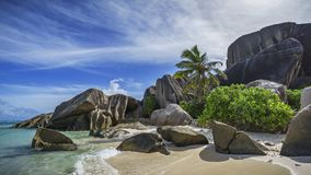 Granite rocks and palm trees at anse source d`argent 5 Royalty Free Stock Images