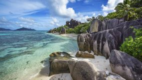 Granite rocks and palm trees at anse source d`argent 2 Royalty Free Stock Images