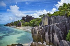 Granite rocks and palm trees at anse source d`argent 3 Royalty Free Stock Photos