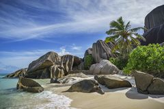 Granite rocks and palm trees at anse source d`argent 6 Royalty Free Stock Images