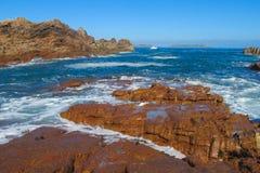 Granite rocks at seaside among waves Stock Photo