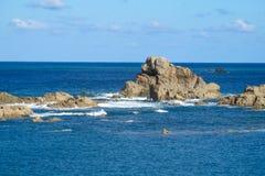 Granite rocks at seaside among waves Royalty Free Stock Photo